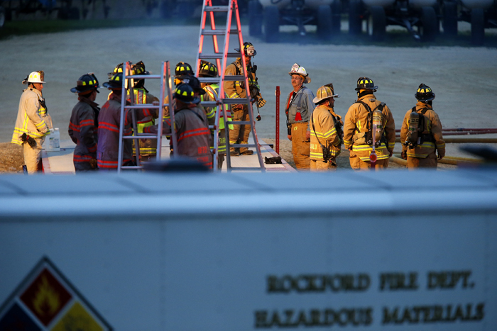 Area firefighters wait on the scene of an anhydrous ammonia leak Tuesday, June 4, 2013, at the Winnebago County Farm Bureau in Rockford. MAX GERSH/ROCKFORD REGISTER STAR ©2013