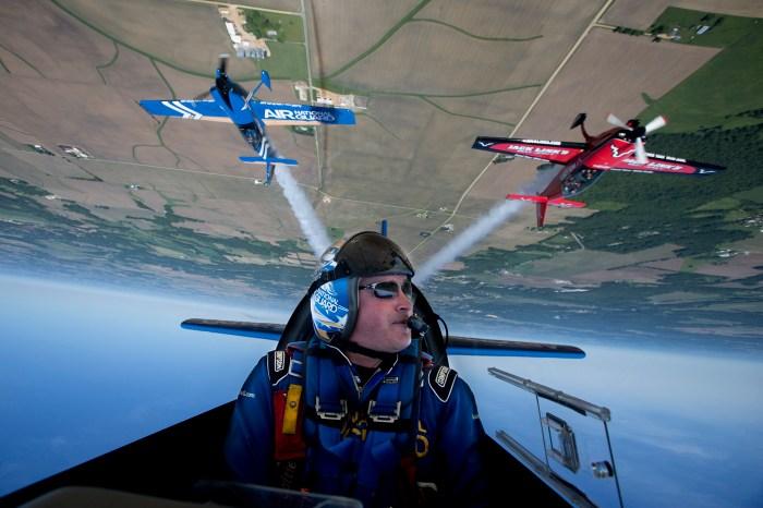 Lt. Col. John Klatt pilots an Air National Guard Extra 300L aerobatic aircraft inverted Thursday, June 5, 2014, in Rockford.