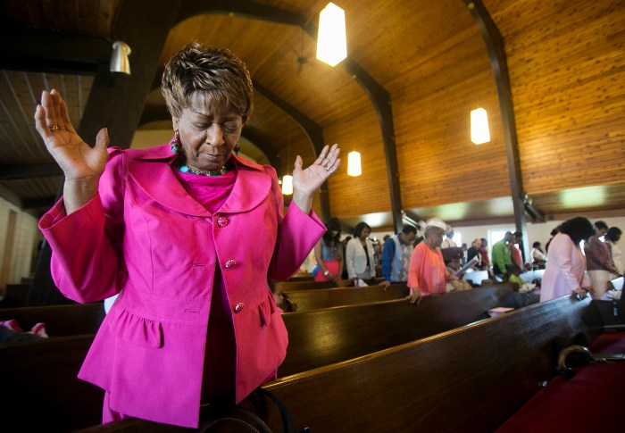 Dorothy Wright prays Sunday, April 20, 2014, during an Easter service at Pilgrim Baptist Church in Rockford. ©2014
