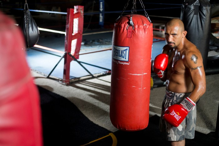 Gus Rodriguez, 31, of Machesney Park, pictured Monday, July 7, 2014, at Fight College Inc. in Rockford, will be competing in his first professional boxing match on Friday in Davenport, Iowa.