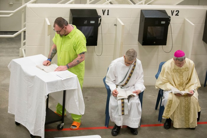 Ryan Rice Sr. reads Sunday, March 27, 2016, during Easter Mass at the Winnebago County Jail in Rockford. MAX GERSH/STAFF PHOTOGRAPHER/RRSTAR.COM ©2016