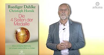 """Dr. Ruediger Dahlke mit seinem Buch """"Die 4 Seiten der Medaille"""""""