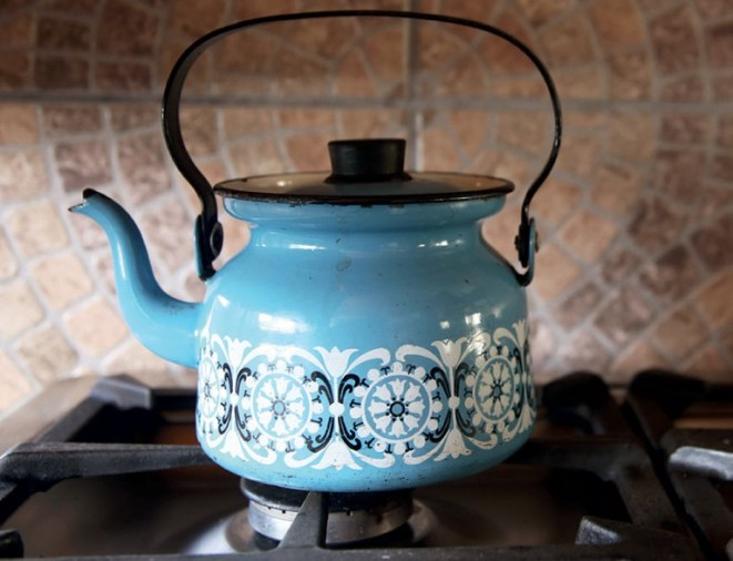 A pot of water boils in Mamma Swartbooi's kitchen in Kayamandi. - Photo by Vuyi Qubeka