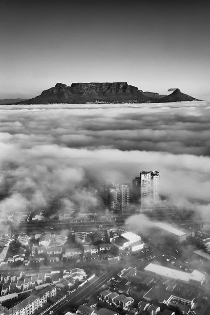 I was shooting the 2016 Lipton Cup Challenge from a helicopter in Cape Town. The weather closed in and we couldn't see the yachts… so I chose to shoot the landscape instead, ending up with this unique image. I later converted it to monochrome for effect. - By Craig Fouché, Worcester Nikon D4