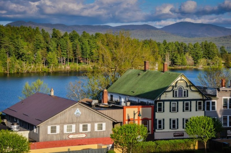 Houses on Mirror Lake in Lake Placid, New York #VisitAdks #Adirondacks @GetawayMavens