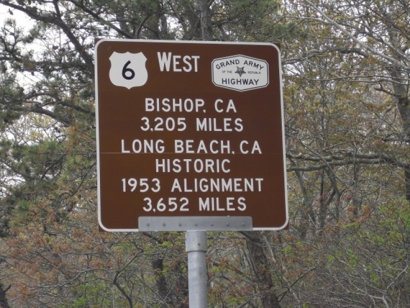 Brown US Route 6 Sign stating Bishop, CA 3,205 Miles Long Beach, CA 3652 Miles