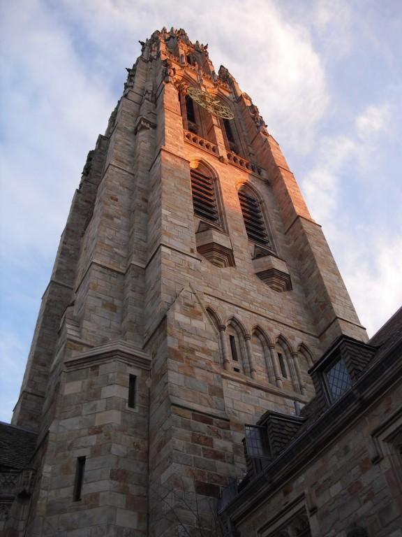 Gothic tower of Yale University shot skyward at sunset. Yale University, New Haven, CT
