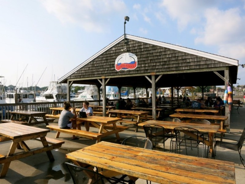picnic tables of fried New England fare hotspot, Captain Scotts on New London CT docks
