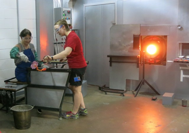 Author making glass flower at Corning Museum of Glass, Corning NY