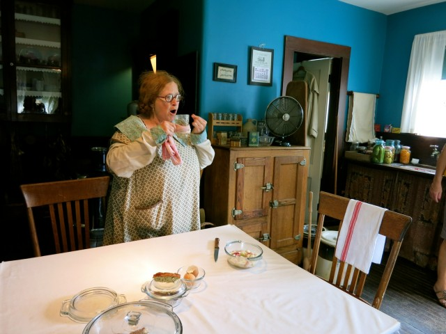 Sheva Shapiro demonstrates Russian method of drinking tea through a sugar cube at Strawbery Banke Museum, Porstmouth NH