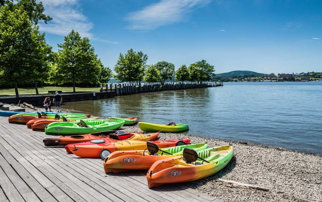 Kayaks lined up on Hudson River shore at Long Dock Park in Beacon, New York