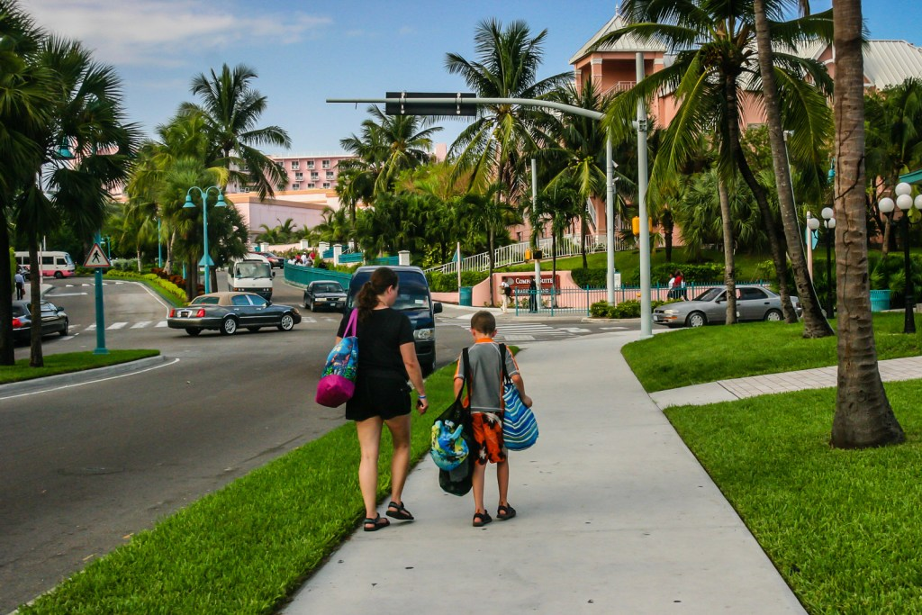 Mother and son walking to Nassau Bahamas Comfort Suites