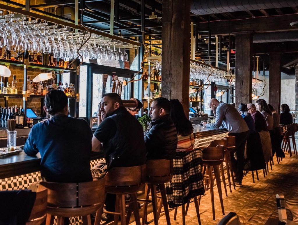 People sitting at the counter. Sugarcane Raw Bar - Brooklyn NY