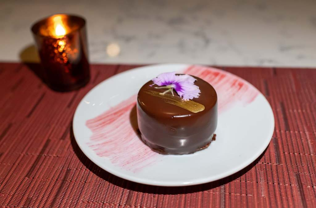 Mini chocolate cake decorated with pansy flower at Grand Tavern in St. Louis MO.