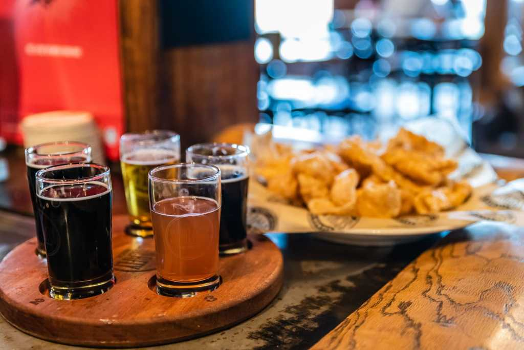 Beer sampler and pork rinds at Schlafly Brew Pub in St. Louis MO.