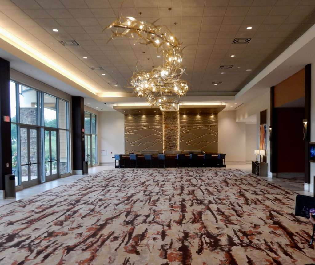 Glass ribbon chandelier in modern event space