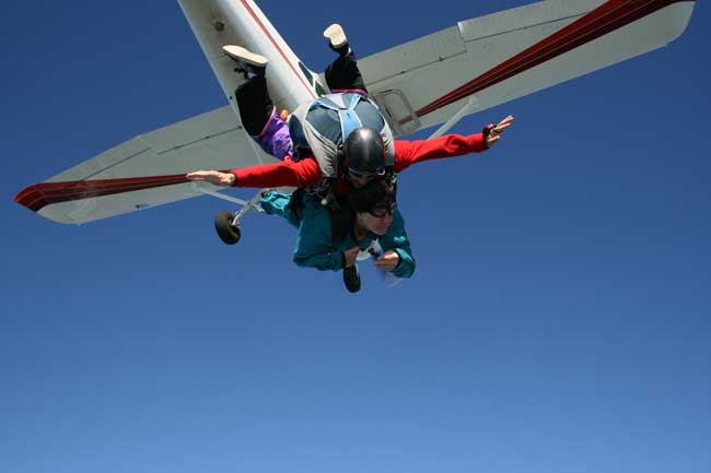 Image of Darian and Rick right after they jumped out of the airplane. The plane is just above them and they are in free fall.