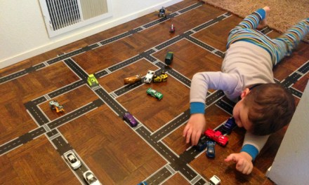 Civil Engineer Tape Lays Roads on the Carpet