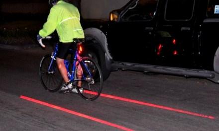 Bicycle Rear Laser Tail Light Creates a Virtual Bike Lane