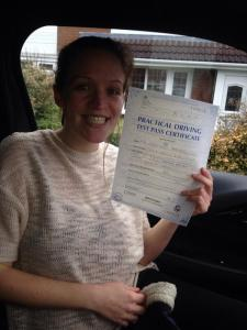 Leanne with driving test pass certificate