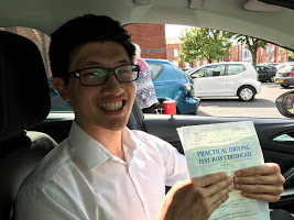 Seans beaming amile showing off his driving test pass