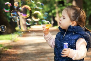 Image result for child blowing bubbles