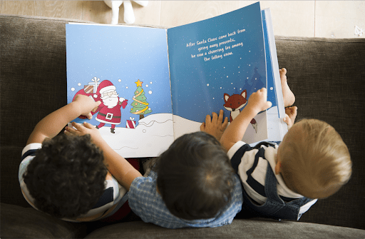 Kids reading holiday picture books together
