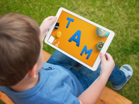 A child using an educational app on his iPad.