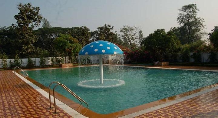 Moss the resort: swimming poll in north mumbai