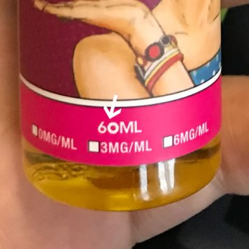 The bottle volume is visibly altered and the nicotine concentration is not marked on the bottle.