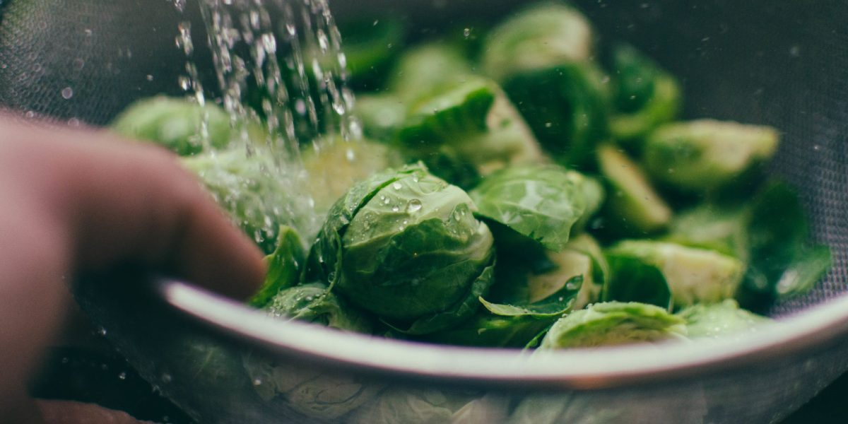 Beautiful shot of water falling on Brussel sprouts