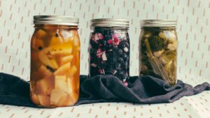 Line up of three jars with three different colored ingredients pickling inside - The Mummy
