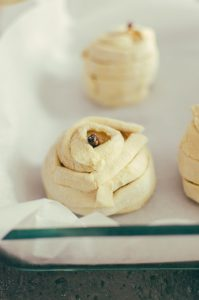 poached pears wrapped in puff pastry sitting in a pan - The Mummy
