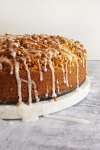 side view of coffee cake with sugar glaze drippings