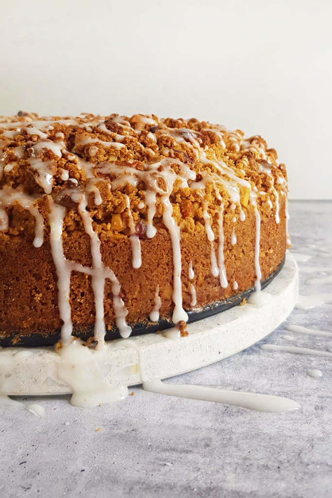 side view of coffee cake with sugar glaze drippings.