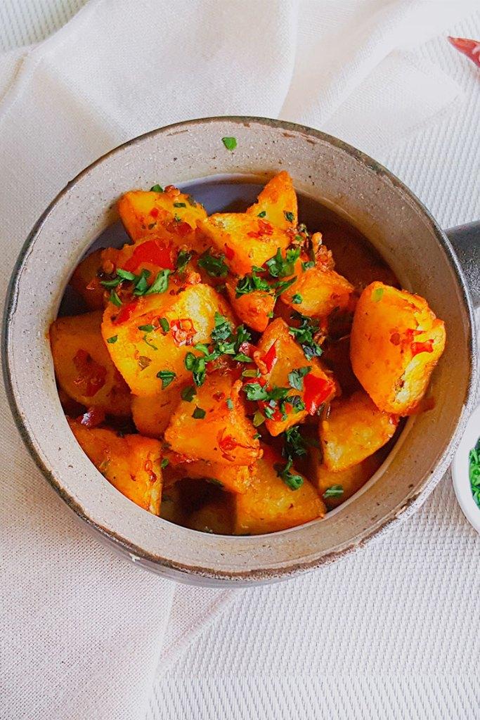 Batata harra served in bowl