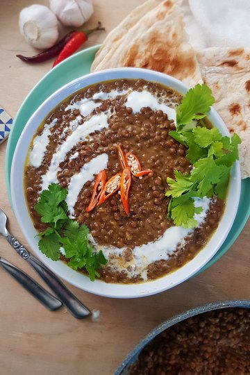 lentil curry served with garlic naan
