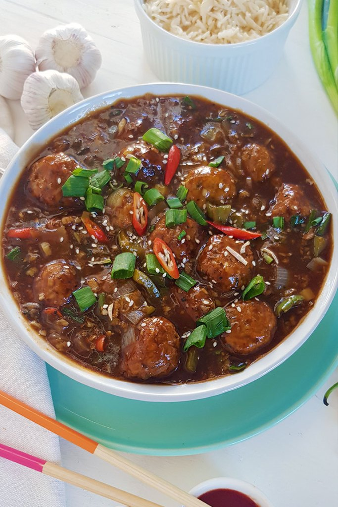 Veg Manchurian in a bowl served with white rice