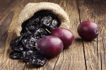 Bone Health ~ Topical Tips Prunes with plums in small sack on old wooden table