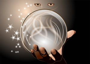 eyes peering at a crystal ball in the palm of a hand