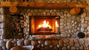 fire in stone fireplace