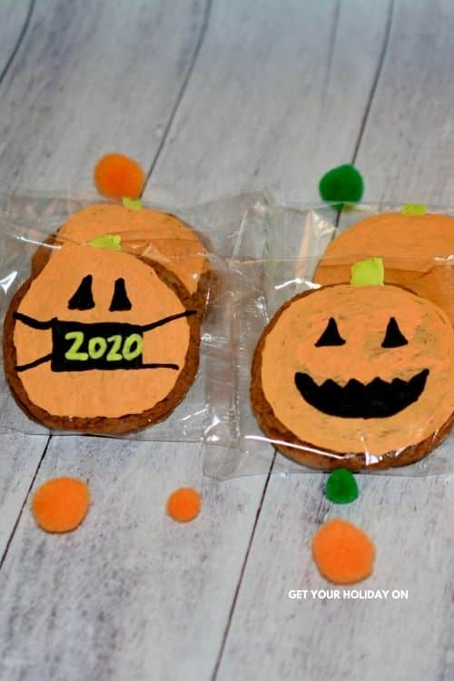 Pumpkin Oatmeal Creme Pies in a wrapper decorated and could be used for party favors!