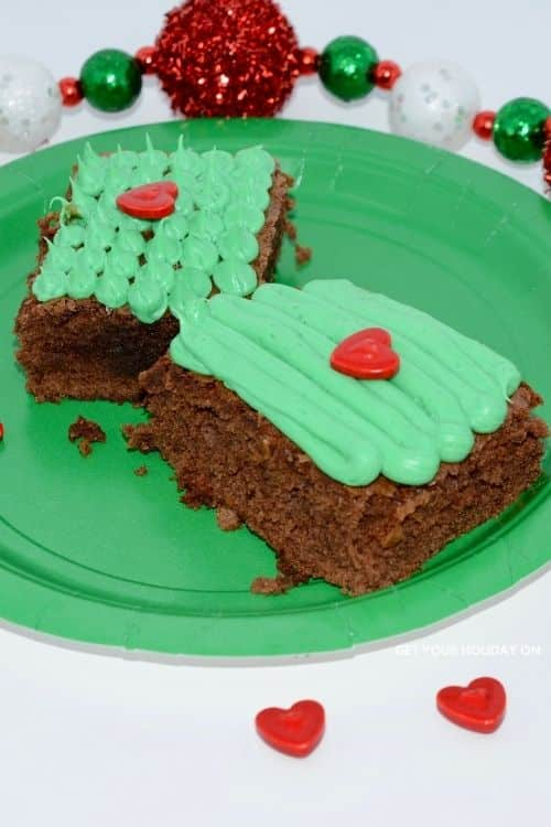 milk chocolate brownies with a grinch icing and decorations.