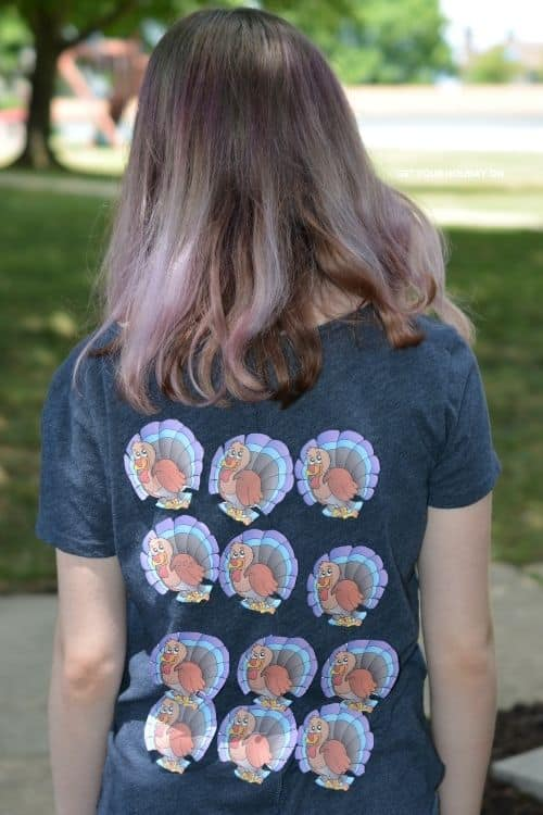 What the shirt looks like full of turkeys on the back of it.