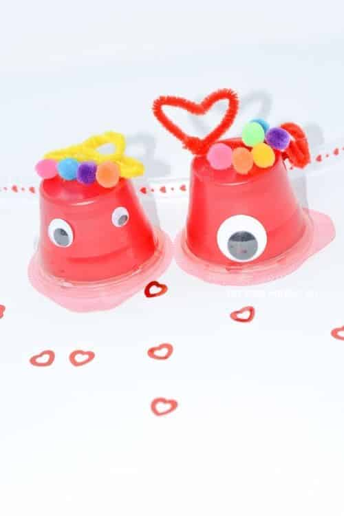 You will need pom poms, pipe cleaners, scissors, jello, google eyes, and scissors to create this Valentine's Day Craft Monsters.