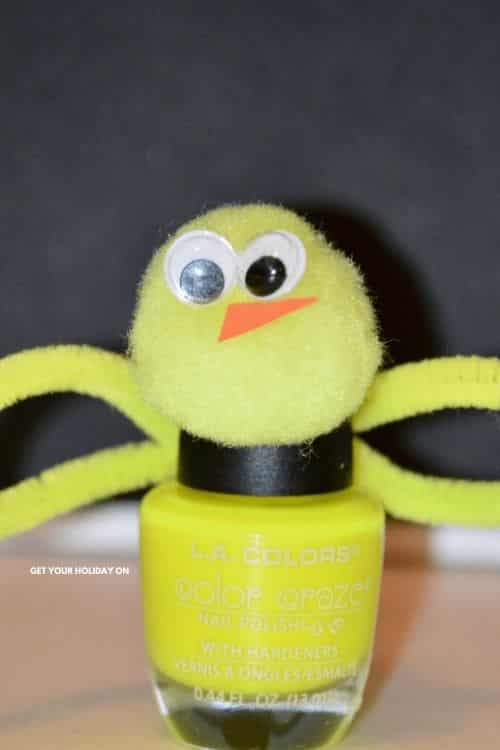 In learning how to make easter nail polish you will find our baby Chick Nail polish with a pom pom head, orange peek, and yellow pipe cleaner to finish off this yellow bottle.