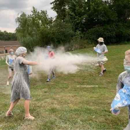 Large group games for youth that is a flour fight battle.