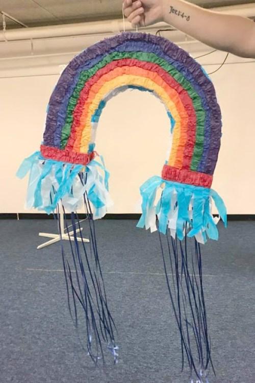Easily assemble a regular pinata like this rainbow into a pull string pinata.