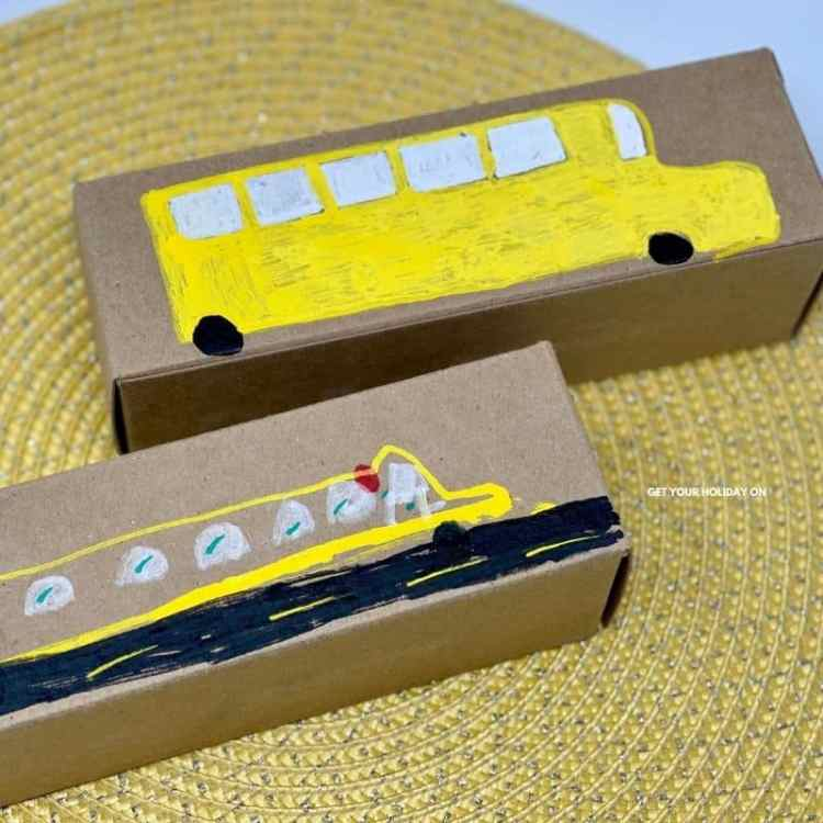 School bus craft that is an art project for a wheels on the bus craft idea.