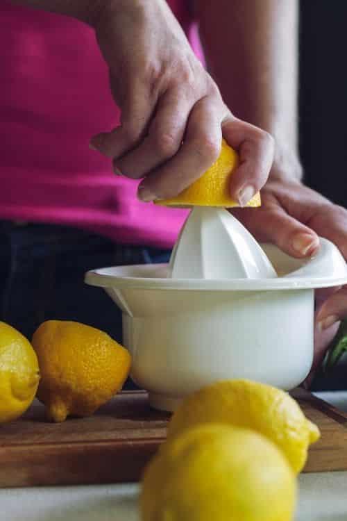 Mom preparing lemonade for her kids.